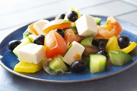 Greek salad with feta cheese and sun dried olives, bright image