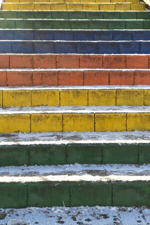 Stair which rainbow colors painted Treads, bright winter, vertical