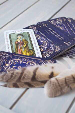 Esoteric still life with tarot card and feathers of owl, vertical image 写真素材