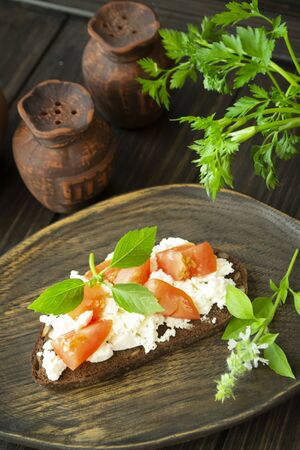 Bruschetta with ricotta cheese, fresh basil and tomato. Vertical image
