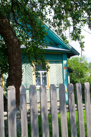 Authentic colourfully painted old wooden house in Belarus