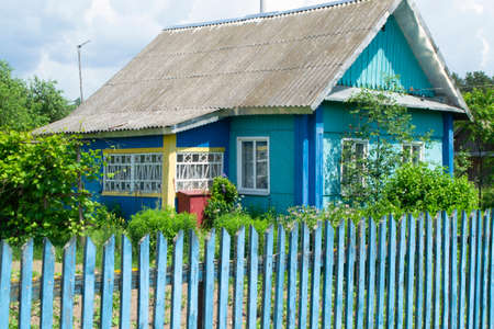 A traditional folk wooden house in Belarus with colorful ornamented