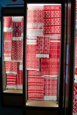 texture of towels embroidered with the national red and white at the fair of folk crafts, collection, Belarus