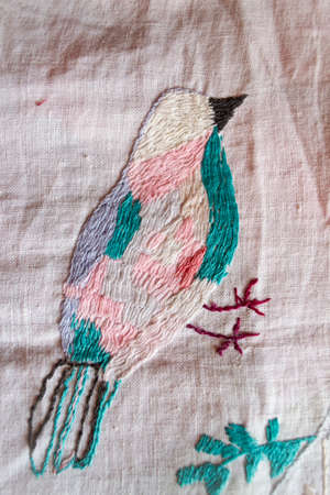 pigeon handmade embroidered smooth decoration on white fabric , vintage folk embroidery in Belarus, second half of 19 century