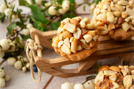 Muffins with peanut nuts close up, Christmas holiday decoration