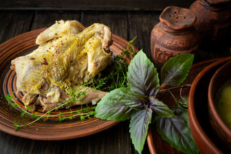 roast wild partridge plated meal on rustic table and brown plate Stockfoto