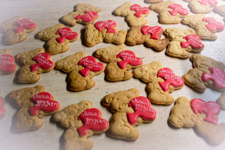 many Teddy bear cookies, decorated with red hearts