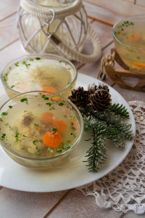 Jellied fish with egg and vegetables on an shabby table