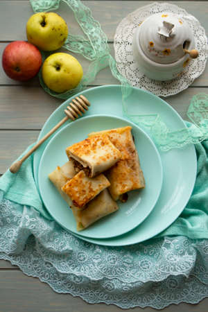 Pancake rolls with apple and honey, belarusian dish