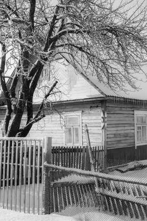 The old wooden house in belarussian or russian village Standard-Bild