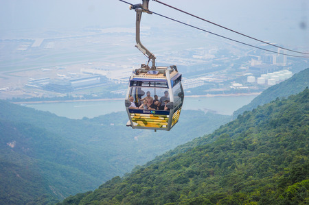 LANTAU HONGKONG-SEP 1  Ngong Ping 360 Cable Car for travel  Ngong Ping village with mountain background on September 1,2013 at Lantau,Hongkong 에디토리얼