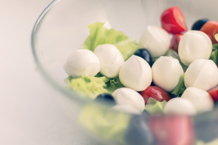 Vegetable salad with cherry tomato, olives and mozarella, toned Imagens