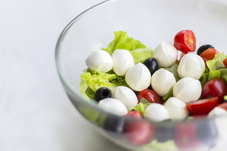 Vegetable salad with cherry tomato, olives and mozarella
