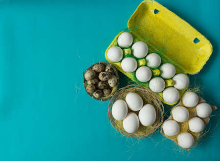 White chicken Chicken and quail eggs in colored paper eco-friendly packaging with decorative sisal.