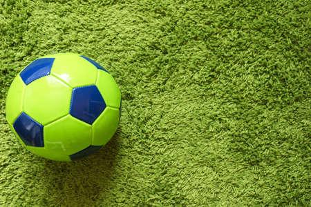 Football (Soccer) ball on a green surface imitating artificial grass. Sports photography 版權商用圖片