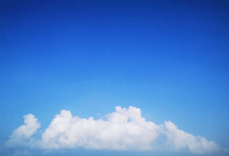 Bright blue sky with beautiful white clouds. Summer photo.