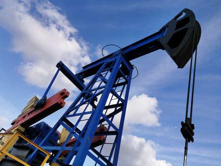 Oil Drilling Rig. Pump Jack and Oil Wellhead.