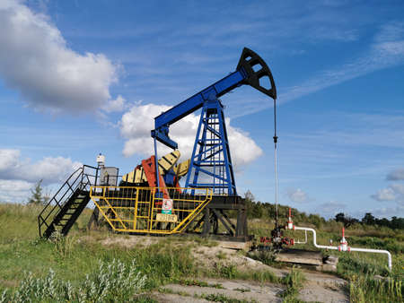 Oil Drilling Rig. Pump Jack and Oil Wellhead.