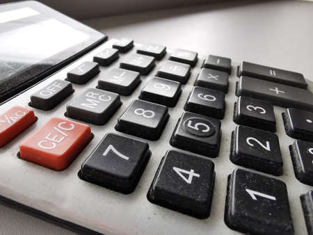 Office Calculator Close Up: Making Calculations, Savings. Finances and Economy Concept Stock Photo