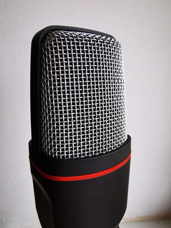 Wireless microphone on white background. A tool for recording and playing music, voice.