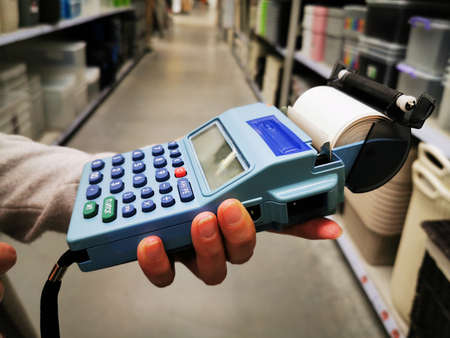 Woman Typing by Payment Machine, POS Terminal Confirms the Contactless Payment by Debit Credit Card, Bank Payment Terminal, Processing NFC Payments Device, Wireless Payment Concept Stock fotó