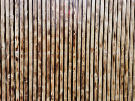 Wooden thin slats with traces of firing. Thin vertical slats.Wooden background. Abstract background. Standard-Bild - 136447996