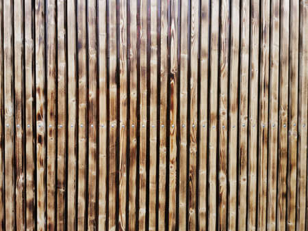 Wooden thin slats with traces of firing. Thin vertical slats.Wooden background. Abstract background. Standard-Bild - 136448000