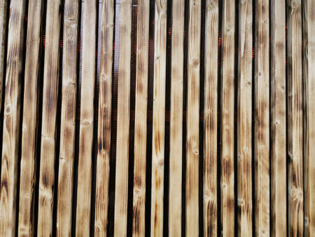 Wooden thin slats with traces of firing. Thin vertical slats.Wooden background. Abstract background. Standard-Bild - 136448001