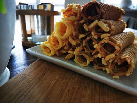 Waffle rolls. Delicious dessert holiday food. Homemade pastries. Fresh raw. Confectionery, snack crunchy dessert. Standard-Bild - 136448032