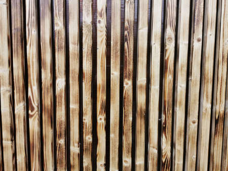 Wooden thin slats with traces of firing. Thin vertical slats.Wooden background. Abstract background. Standard-Bild - 136448049