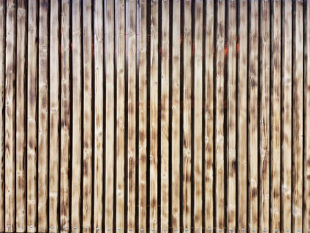 Wooden thin slats with traces of firing. Thin vertical slats.Wooden background. Abstract background. Standard-Bild - 136448056