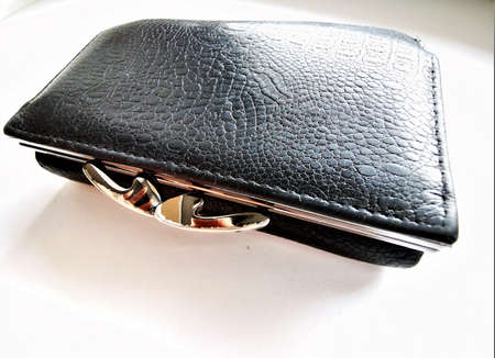 Black leather men's wallet with many pockets and compartments for credit and discount cards. Classical model. Wallet in the closed. Finance concept. Top view. Shopping concept. Standard-Bild - 136448096