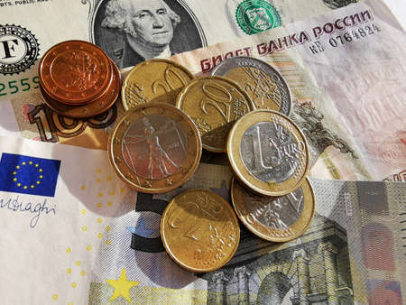 Euro coins and Euro cents. Paper notes of Euro, dollar and Russian rubles. Exchange rate. Buy currency sign. Exchange money. Dollar money cash. Investment concept.