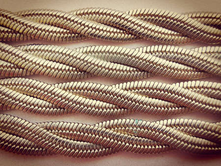 The chain is gold tone, the type of weaving snake. Close-up photo. 版權商用圖片