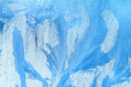 Frost pattern on the glass. Frost on the window. Winter photo. Cryesthesia. Freezing. Macro