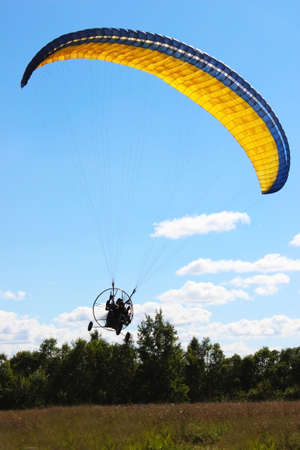 man flying: Parachute Parachuting