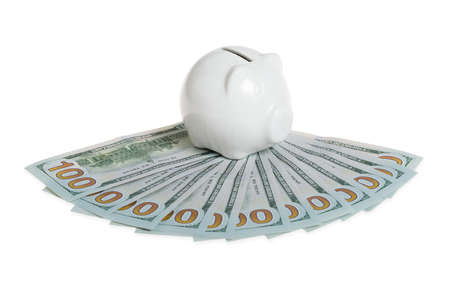 bank activities: piggy bank sat on hundred dollar bills Stock Photo