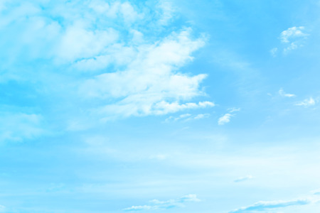 Light clouds in the blue sky. Beautiful nature background. Imagens