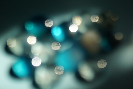 Bright blue and white abstract background with blurred lights.