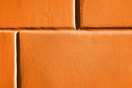 Close up image of ogange brick wall. Color of Spring and Summer 2019.
