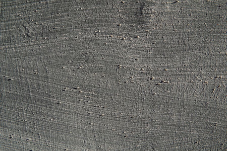Texture of a gray smooth concrete wall.