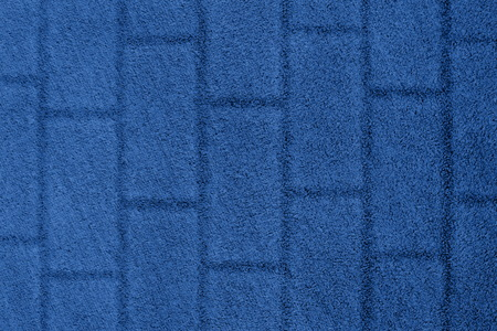 Blue grass background with a brick wall texture. Color of summer 2019.