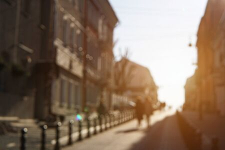 Blurred image of two girlfriends on the street in beautiful evening sun light.