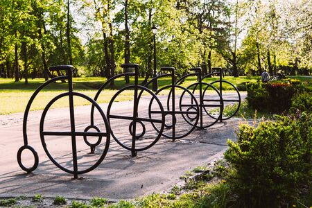 Parking for bicycles in the park. The concept of a healthy lifestyle.