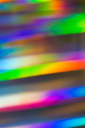 Abstract background of holographic strings of all rainbow colors.
