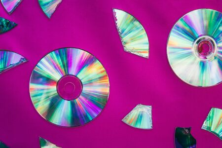 Vintage CD or DVD disk background, old circle discs and treir parts used for data storage, share movies and music.