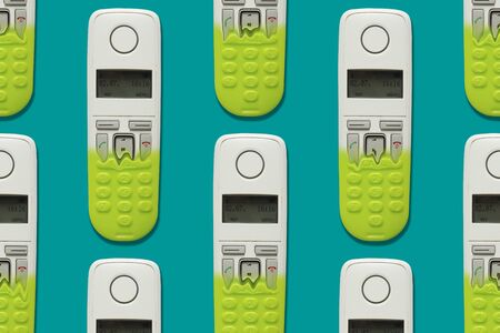 Pattern image of DECT phones turning into a toy phones on blue background. The concept of technology obsolescence. Stock fotó