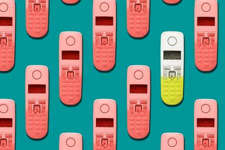Pattern image of DECT phones turning into a toy phones on blue background. The concept of technology obsolescence.