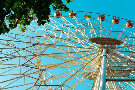 Ferris wheel on the blue sky background. Minsk, Belarus. Фото со стока - 129923153