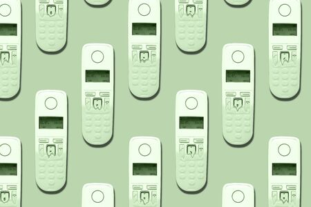 Pattern image of DECT phones turning into a toy phones on trendy mint background. The concept of technology obsolescence.